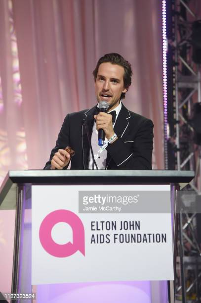 Alexander Gilkes conducts auction at the 27th annual Elton John AIDS Foundation Academy Awards Viewing Party sponsored by IMDb and Neuro Drinks...