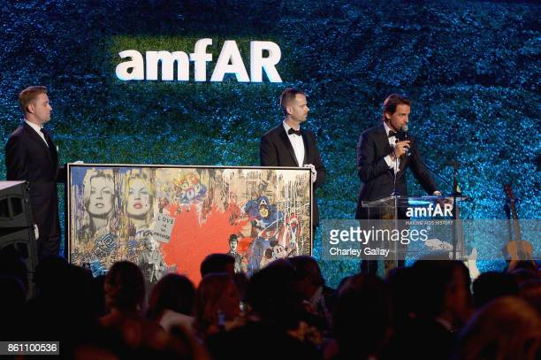 Alexander Gilkes speaks onstage during the amfAR Gala Los Angeles 2017 at Ron Burkle's Green Acres Estate on October 13 2017 in Beverly Hills...