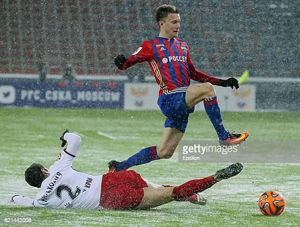 Alexander Golovin of PFC CSKA Moscow challenged by Alexander Milkovich of FC Amkar Perm during the Russian Premier League match between PFC CSKA...