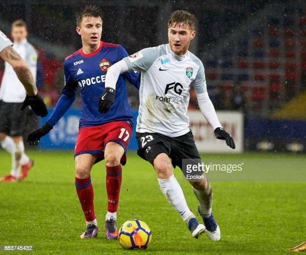 Alexander Golovin of PFC CSKA Moscow vies for the ball with Aleksandr Troshechkin of FC Tosno Saint Petersburg during the Russian Premier League...