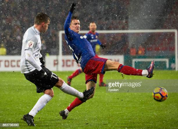 Alexander Golovin of PFC CSKA Moscow vies for the ball with Maksim Paliyenko of FC Tosno Saint Petersburg during the Russian Premier League match...