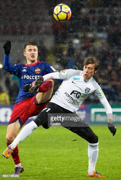 Alexander Golovin of PFC CSKA Moscow vies for the ball with Yan Kazayev of FC Tosno Saint Petersburg during the Russian Premier League match between...