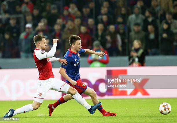 Alexander Golovin of PFC CSKA Moskva vies for the ball with Aaron Ramsey of Arsenal FC during the UEFA Europa League quarter final leg two match...