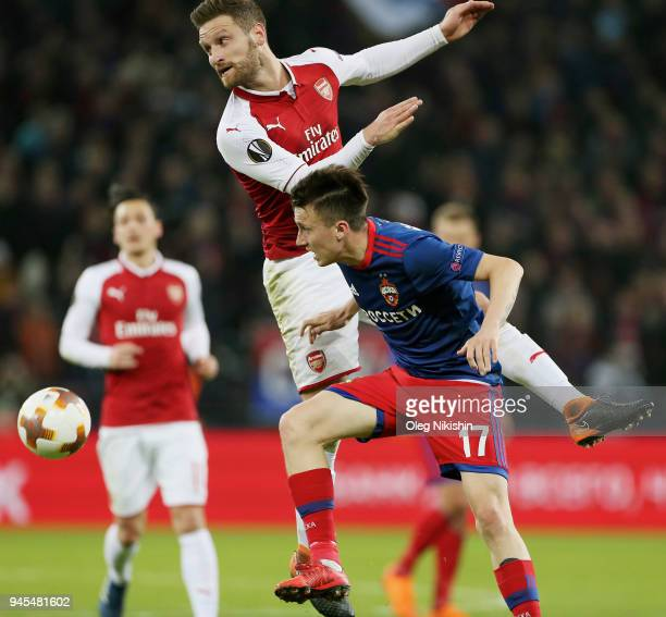 Alexander Golovin of PFC CSKA Moskva vies for the ball with Shkodran Mustafi of Arsenal FC during the UEFA Europa League quarter final leg two match...