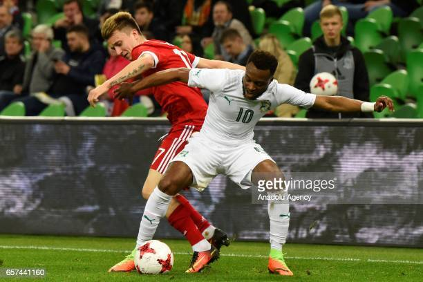 Alexander Golovin of Russia in action against Cheick DOUKOURE Doukoure of Cote d'Ivoire's during the friendly football match at Krasnodar Stadium in...