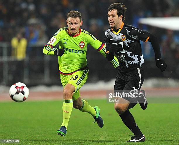 Alexander Gorbatiyk of FC Arsenal Tula is challenged by Fedor Chalov of PFC CSKA Moscow during the Russian Premier League match between FC Arsenal...
