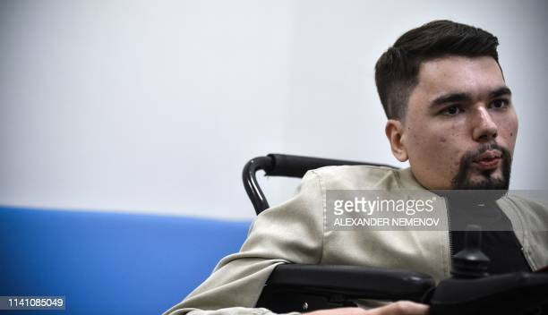 Alexander Gorbunov aslo known as a top Russian opposition blogger StalinGulag talks to AFP correspondent during an interview in Moscow on May 3 2019...