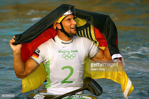 Alexander Grimm of Germany celebrates after winning the gold medal the Kayak Men's Final held at the Shunyi Olympic RowingCanoeing Park on Day 4 of...