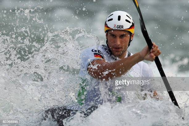 Alexander Grimm of Germany competes in the 2008 Beijing Olympic Games men's single Kayak K1 final event at the Shunyi Rowing and Canoeing Park in...