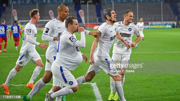 Alexander Groiss David Pisot Anton Fink Damian Rossbach and Manuel Stiefler of Karlsruhe celebrate their teams secod goal during the 3 Liga match...