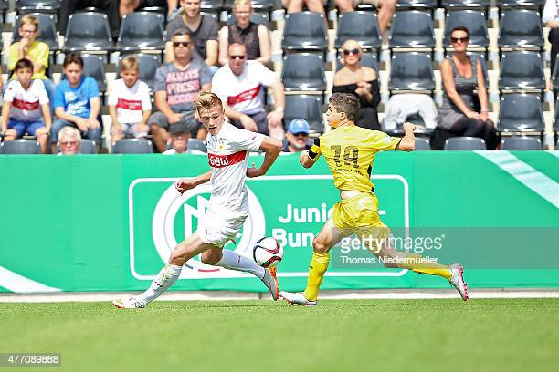 Alexander Groiss of Stuttgart fights for the ball with Christian Pulisic of Dortmund during the Bjuniors German championship final between VfB...
