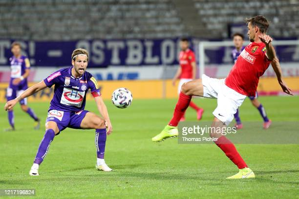 Alexander Gruenwald of Austria Wien and Markus Lackner of Admira compete for the ball during the tipico Bundesliga match between FK Austria Wien and...