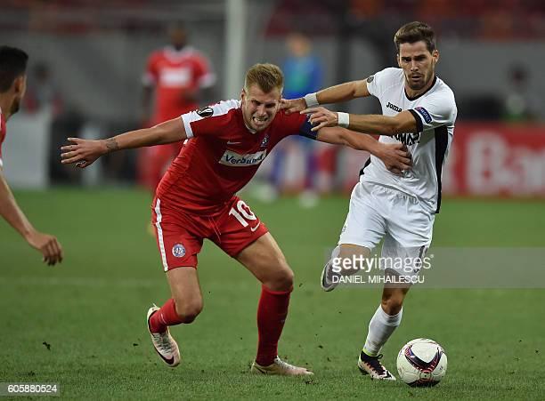 Alexander Grunwald of FK Austria Wien vies for the ball with Junior Morais of FC Astra Giurgiu during the UEFA Europa League Group E football match...