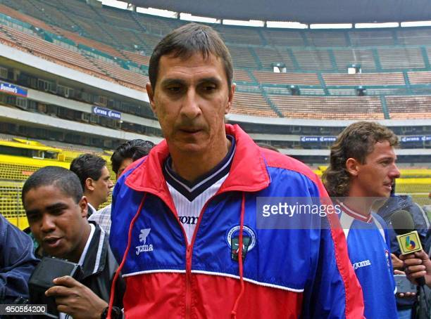 Alexander Guimaraes head coach of the Costa Rican soccer team talks to the press after practice at the Azteca Stadium in Mexico City 15 June 2001...