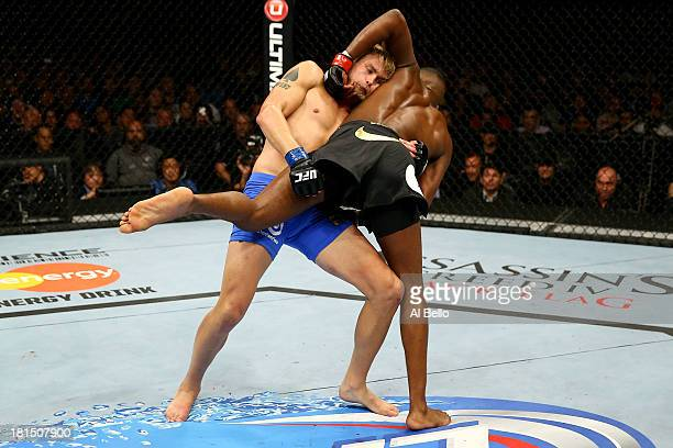 Alexander Gustafsson attempts a takedown on Jon Jones in their UFC light heavyweight championship bout at the Air Canada Center on September 21, 2013...