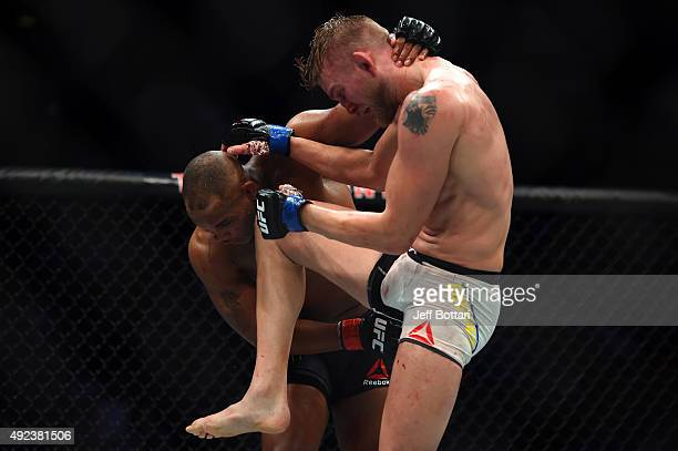 Alexander Gustafsson lands a knee to the head of Daniel Cormier in their UFC light heavyweight championship bout during the UFC 192 event at the...