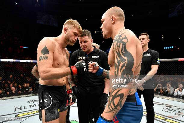 Alexander Gustafsson of Sweden and Anthony Smith touch gloves before their light heavyweight bout during the UFC Fight Night event at Ericsson Globe...