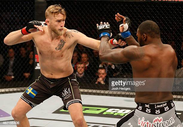 Alexander Gustafsson of Sweden battles Anthony Johnson of the United States in their light heavyweight bout during the UFC Fight Night event at the...