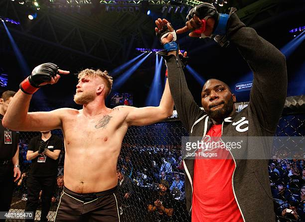 Alexander Gustafsson of Sweden congratulates Anthony Johnson of the United States after Johnson defeated Gustafsson in their light heavyweight bout...