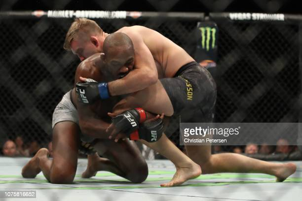 Alexander Gustafsson of Sweden controls the body of Jon Jones in their light heavyweight bout during the UFC 232 event inside The Forum on December...