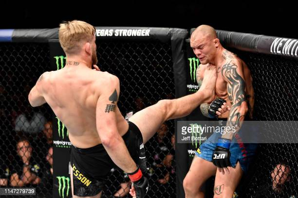 Alexander Gustafsson of Sweden kicks Anthony Smith in their light heavyweight bout during the UFC Fight Night event at Ericsson Globe on June 1 2019...