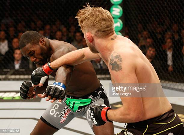 Alexander Gustafsson of Sweden punches Anthony Johnson of the United States in their light heavyweight bout during the UFC Fight Night event at the...