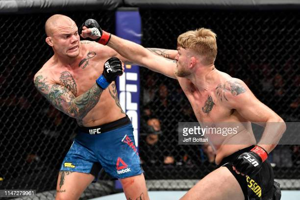 Alexander Gustafsson of Sweden punches Anthony Smith in their light heavyweight bout during the UFC Fight Night event at Ericsson Globe on June 1,...