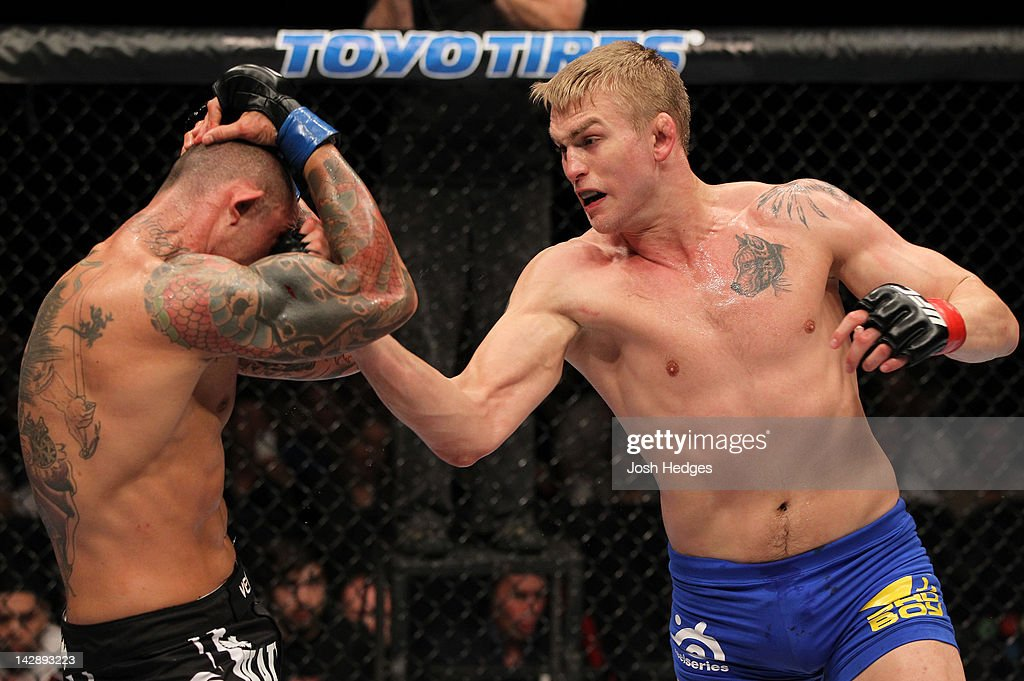 Alexander Gustafsson punches Thiago Silva during their light heavyweight bout at the UFC on Fuel TV event at Ericsson Globe on April 14, 2012 in Stockholm, Sweden.