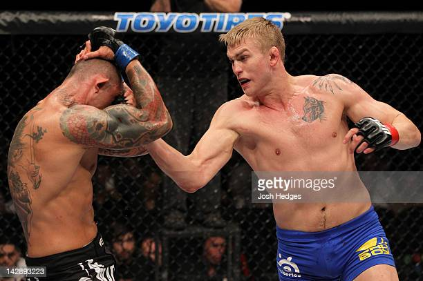 Alexander Gustafsson punches Thiago Silva during their light heavyweight bout at the UFC on Fuel TV event at Ericsson Globe on April 14 2012 in...