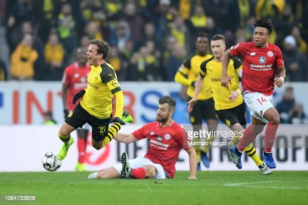 Alexander Hack of FSV Mainz fouls Mario Gotze of Borussia Dortmund during the Bundesliga match between 1 FSV Mainz 05 and Borussia Dortmund at Opel...