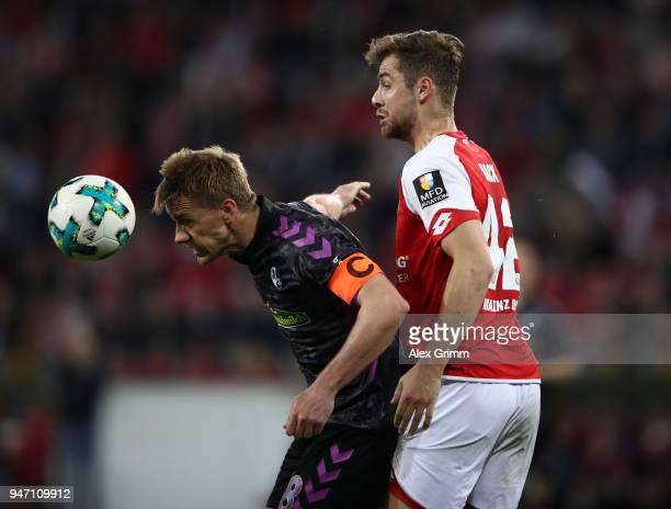 Alexander Hack of Mainz challenges Nils Petersen of Freiburg during the Bundesliga match between 1 FSV Mainz 05 and SportClub Freiburg at Opel Arena...