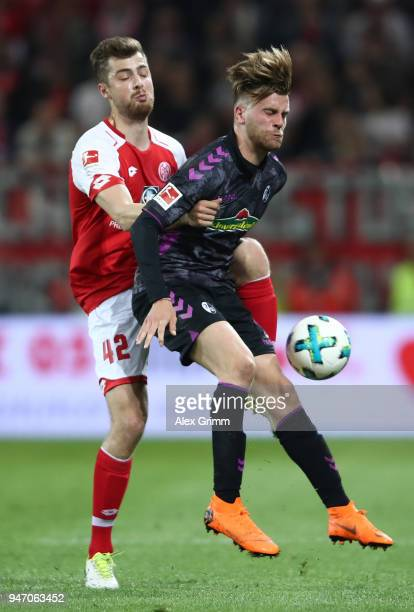 Alexander Hack of Mainz is challenged by Lucas Hoeler of Freiburg during the Bundesliga match between 1 FSV Mainz 05 and SportClub Freiburg at Opel...