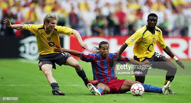 Alexander Hleb and Kolo Toure of Arsenal challenge Ronaldinho of Barcelona for the ball during the UEFA Champions League Final between Arsenal and...