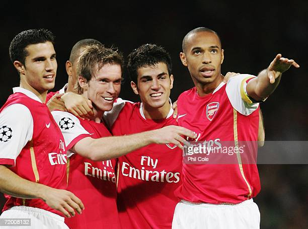 Alexander Hleb of Arsenal celebrates scoring the second goal with team mates Robin Van Persie Francesc Fabregas and Thierry Henry during the UEFA...