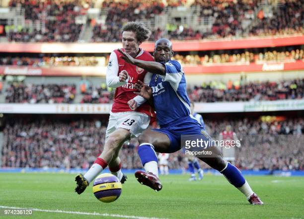 Alexander Hleb of Arsenal clashes with Noe Pamarot of Portsmouth during the Barclays Premiership match between Arsenal and Portsmouth at the Emirates...