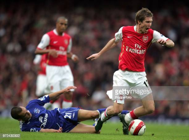 Alexander Hleb of Arsenal is brought down by Leon Osman of Everton during the Barclays Premiership match between Arsenal and Everton at The Emirates...
