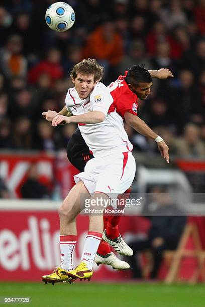 Alexander Hleb of Stuttgart and Arturo Vidal of Leverkusen jump for a header during the Bundesliga match between Bayer Leverkusen and VfB Stuttgart...
