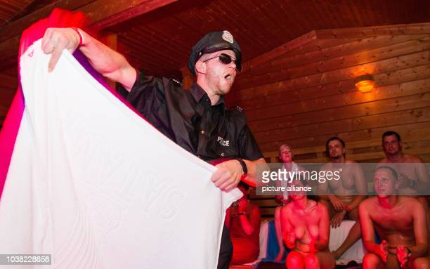 Alexander Hoffmann participant at the German Sauna Championships 2016 shows on his show program Der Polizist in a sauna of Solymar Therme in Bad...