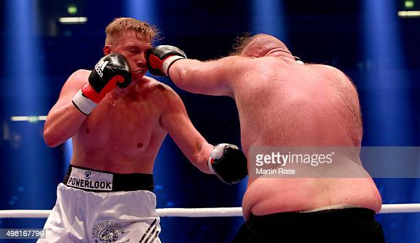 Alexander Hofmann of Germany exchange punches with Guerkan Basak of Germany during their heavy weight fight at TUI Arena on November 21 2015 in...