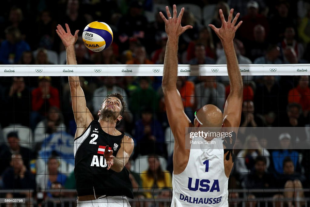 Alexander Huber of Austria spikes the ball against Phil Dalhausser of United States during a Men's Round of 16 match between the United States and Austria on Day 8 of the Rio 2016 Olympic Games at the Beach Volleyball Arena on August 13, 2016 in Rio de Janeiro, Brazil.