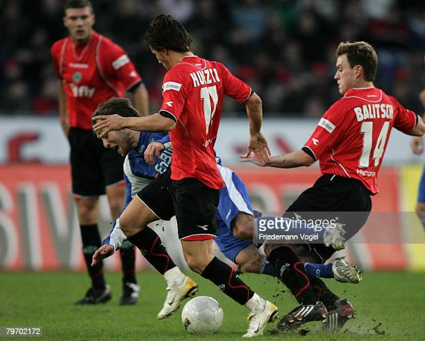 Alexander Iashvili of Karlsruhe fights for the ball with Szabolcs Huszti and Hanno Balitsch of Hannover during the Bundesliga match between Hannover...