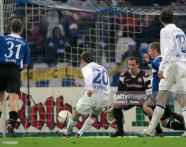 Alexander Iashvili of Karlsruhe tries to score while Radim Kucera , Mathias Hain and Oliver Kirch look on during the Bundesliga match between...