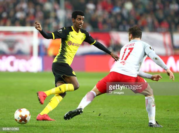 Alexander Isak of Dortmund and Andreas Ulmer of Salzburg battle for the ball during UEFA Europa League Round of 16 second leg match between FC Red...
