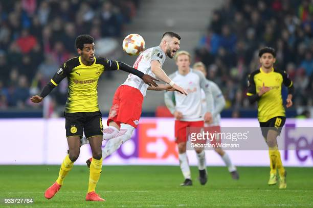 Alexander Isak of Dortmund and Valon Berisha of Salzburg compete for the ball during the UEFA Europa League Round of 16 2nd leg match between FC Red...