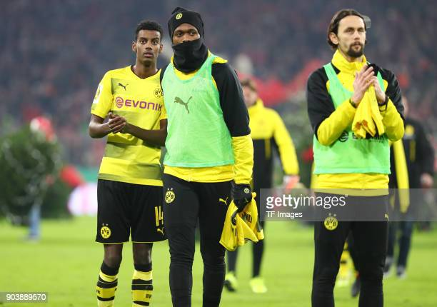 Alexander Isak of Dortmund DanAxel Zagadou of Dortmund and Neven Subotic of Dortmund look dejected after the DFB Cup match between Bayern Muenchen...