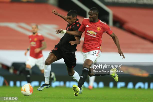 Alexander Isak of Real Sociedad and Eric Bailly of Manchester United during the UEFA Europa League Round of 32 Leg Two match between Manchester...
