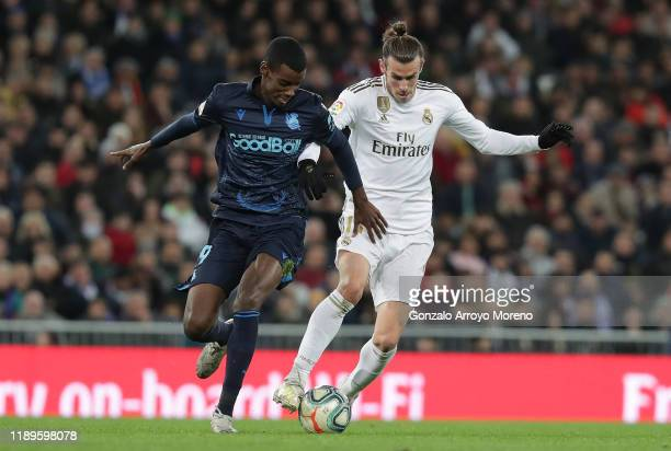 Alexander Isak of Real Sociedad battles for possession with Gareth Bale of Real Madrid during the La Liga match between Real Madrid CF and Real...