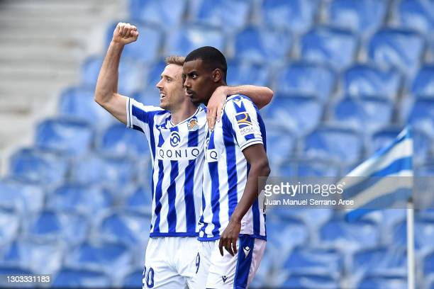 Alexander Isak of Real Sociedad celebrates with Nacho Monreal after scoring his team's first goal during the La Liga Santander match between Real...