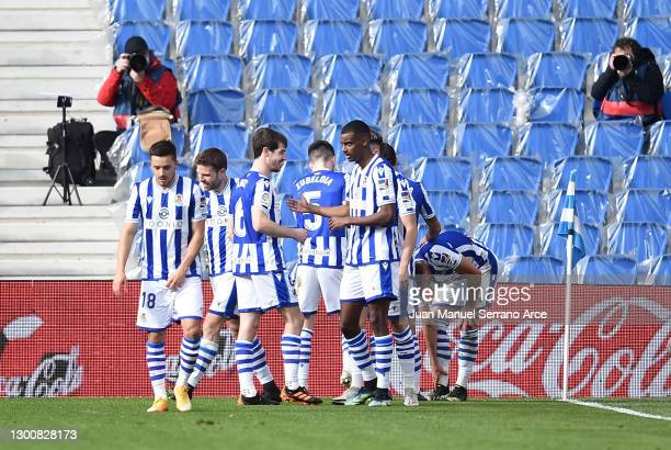 Alexander Isak of Real Sociedad celebrates with team mates after scoring their side's third goal during the La Liga Santander match between Real...