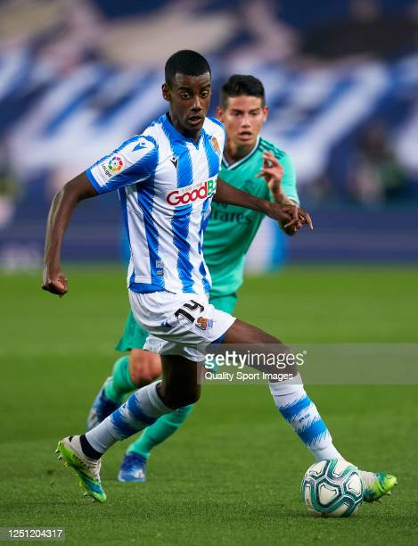 Alexander Isak of Real Sociedad competes for the ball with James Rodriguez of Real Madrid during the La Liga match between Real Sociedad and Real...